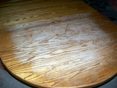 After years of service as the family table, the finish was worn and dull.